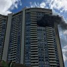 Smoke billows from a high-rise apartment building in Honolulu (AP)