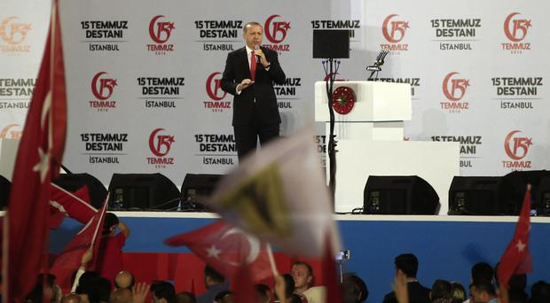 Turkey's President Recep Tayyip Erdogan speaks at the July 15 Martyr's bridge to commemorate the one-year anniversary of the botched coup attempt (AP)