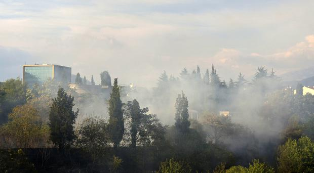 Smoke rises over the Montenegro capital Podgorica as firefighters try to contain wildfires along the Adriatic coast (AP/Risto Bozovic)