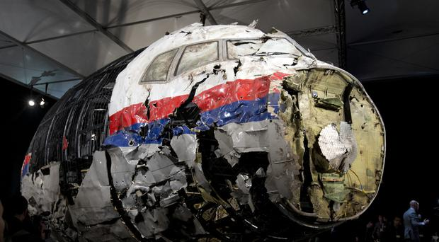 The reconstructed wreckage of Malaysia Airlines Flight MH17 (AP/Peter Dejong)