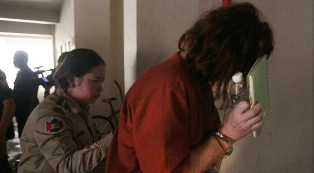 Tammy Davis-Charles, right, enters court in Cambodia (AP/Heng Sinith)