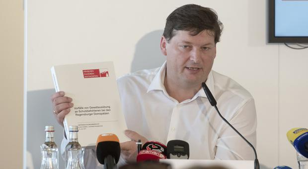 Lawyer Ulrich Weber at a press conference in Regensburg (dpa/AP)