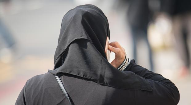 Women in Saudi Arabia must wear loose, long robes and must also cover their face
