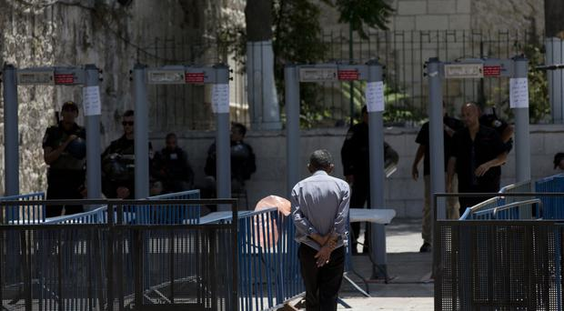 A Palestinian man walks towards a metal detector at the Al Aqsa Mosque compound in Jerusalem's Old City. (AP)