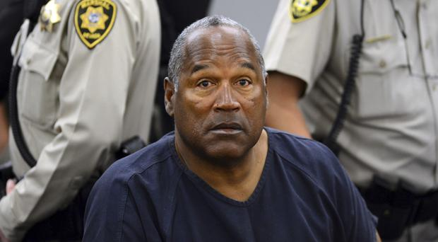 OJ Simpson pictured at a court hearing in Las Vegas in 2013, as the former sports star and actor faces a state parole board (AP Photo/Ethan Miller, Pool, File)