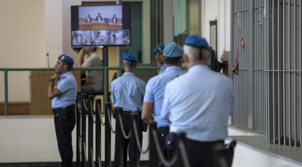 Italian police officers stand inside the court hall during a corruption trial in Rome. (AP)