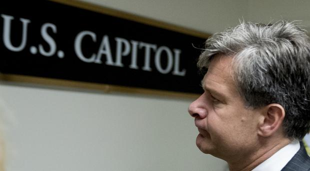 FBI director nominee Christopher Wray walks on Capitol Hill. (AP)