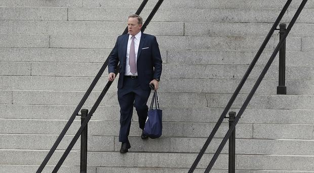 Walking out of the White House - Sean Spicer has quit after a tough six months defending President Donald Trump (AP Photo/Alex Brandon)