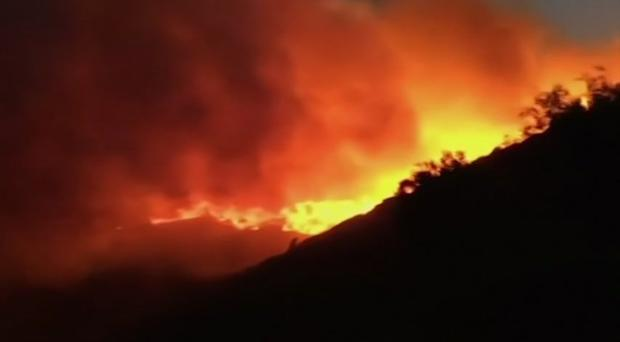 A wildfire burns in Ramatuelle, southern France (AP)