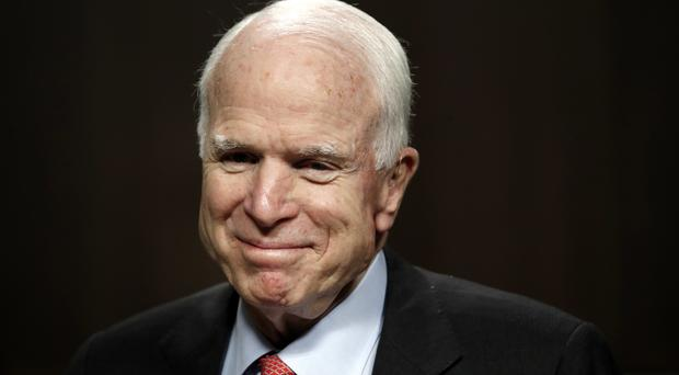 Mr McCain will return to Washington just days after revealing he was being treated for brain cancer (AP)