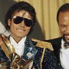 Michael Jackson, left, pictured with Quincy Jones at the Grammy Awards in 1984 (AP)