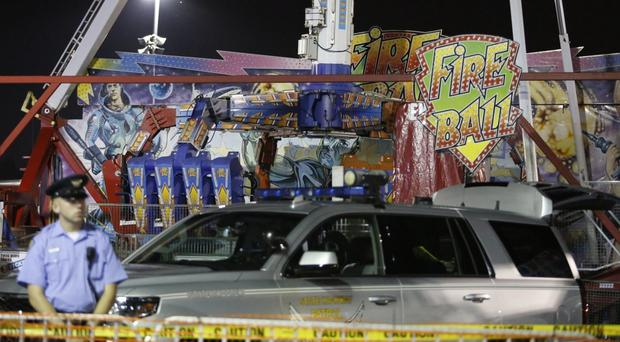 The Fire Ball amusement ride malfunctioned, hurling people into the air (The Columbus Dispatch/AP)