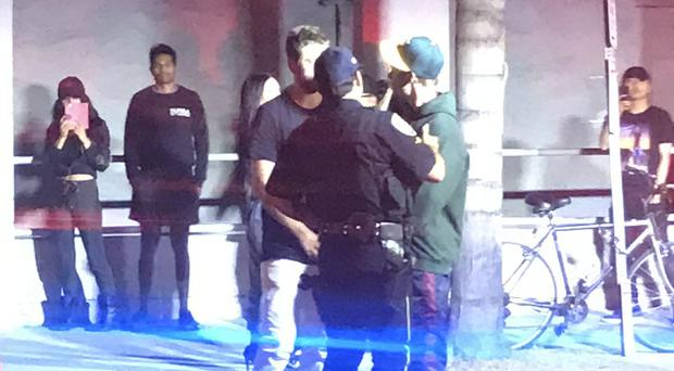 Justin Bieber, right, speaks with two people after the incident in Los Angeles (AP)