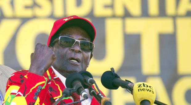 Robert Mugabe has been urged by his wife to name a successor (AP)