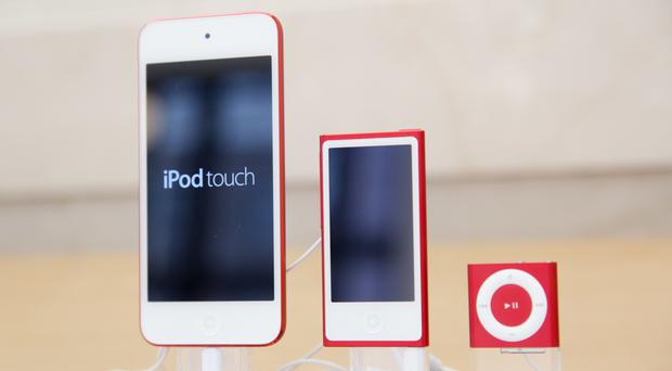 Left to right, the now-discontinued iPod, iPod Nano and iPod Shuffle (AP)