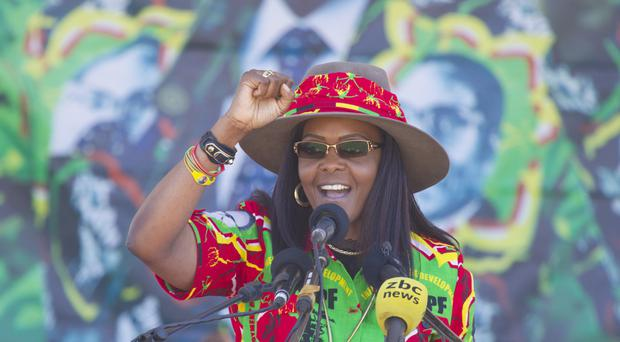 Zimbabwe's first lady Grace Mugabe greets supporters at a rally in Lupane, north of Bulawayo (AP)