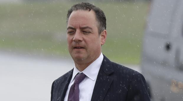 White House chief of staff Reince Priebus kept a 'poker face' aboard Air Force One, according to a politician on the flight (AP)