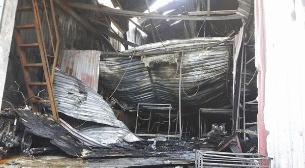 Debris litters the interior of a cake factory in Hanoi, Vietnam, following a fire which killed eight people (AP Photo via Vietnam News Agency)