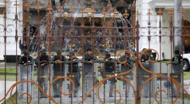 Bolivarian National Guards stand guard inside the National Assembly in Caracas (AP Photo/Ariana Cubillos)