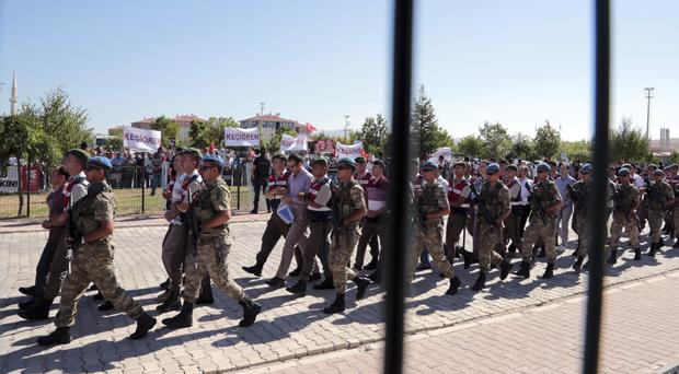 Paramilitary police and special forces members outside the courthouse as the trial of 486 suspects opens in Ankara (Burhan Ozbilici/AP)