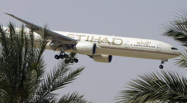 Etihad Airways says it is working with Australian police in its investigation into an attempted plane attack (AP Photo/Kamran Jebreili, File)