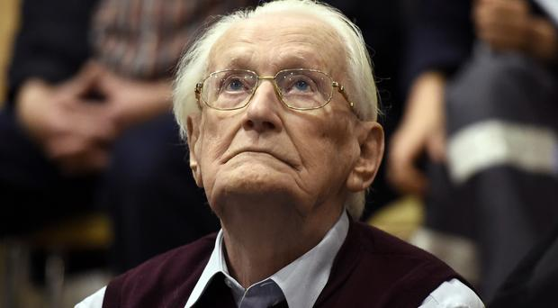 Oskar Groening was convicted in 2015 of being an accessory to the murder of 300,000 Jews (Tobias Schwarz/Pool Photo via AP)
