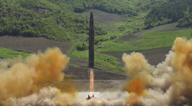 The launch of a Hwasong-14 intercontinental ballistic missile in North Korea's north-west (Korean Central News Agency/Korea News Service via AP)