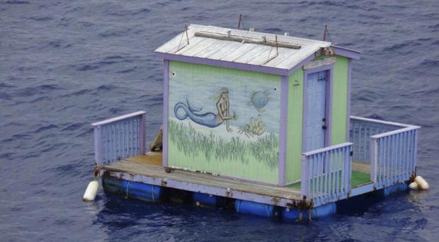 The house floats adrift in the Gulf of Mexico (US Coast Guard via AP)