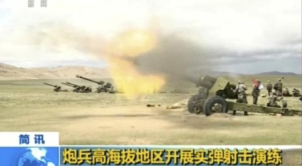 Artillery guns fire during a live-fire drill by the Chinese army in Tibet (China Central Television via AP Video)