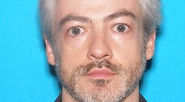 Wyndham Lathem, a microbiology professor at Northwestern University, is wanted for murder (Chicago Police Department/PA)