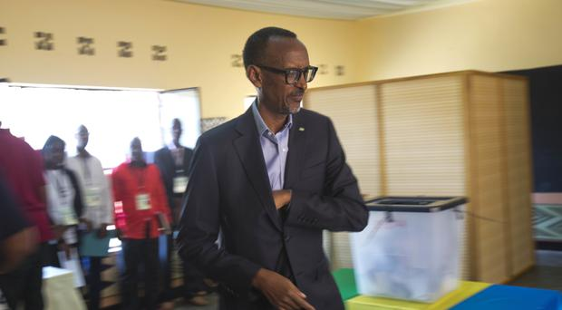 Paul Kagame arrives to cast his ballot in Rwanda's capital Kigali for the presidential elections which he is widely expected to win (AP Photo/Jerome Delay)