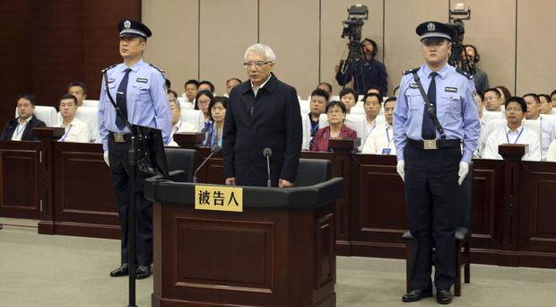 Wang Min, the former Communist Party leader of Liaoning Province, appears in court in Luoyang (Xinhua via AP)