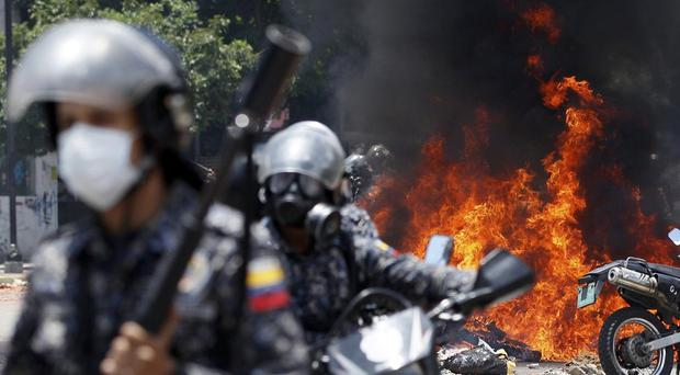 Venezuela's security forces were allegedly responsible for the deaths of at least 46 people, the UN said (AP)