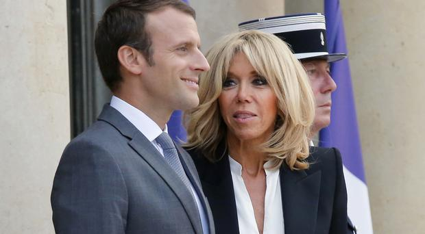 French President Emmanuel Macron with his wife Brigitte (AP)