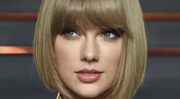 Taylor Swift claims she was groped by a DJ in 2013 (Invision/AP)