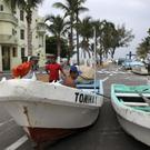 Fishermen secure their boats ahead of the arrival of Hurricane Franklin in the port city of Veracruz (AP)