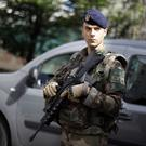 A soldier stands near the scene where French soldiers were hit and injured by a vehicle in the western Paris suburb of Levallois-Perret (Kamil Zihnioglu/AP)