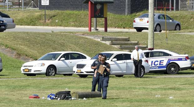 Police examine the scene of the log drill tragedy at Sachem High School East (Newsday/AP)