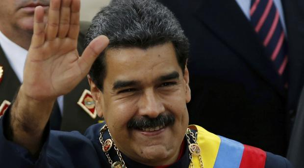 Hand of friendship? Venezuela's president Nicolas Maduro says he wants as strong a relationship with the US as he does with Russia (AP)