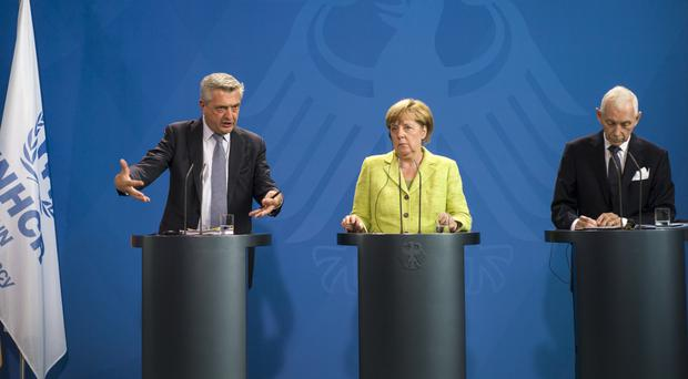 German Chancellor Angela Merkel with UN High Commissioner for Refugees Filippo Grandi and Director General of the International Organisation for Migration William Lacy Swing. (AP)