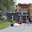 Firefighters at the accident site near Nagold. (AP)