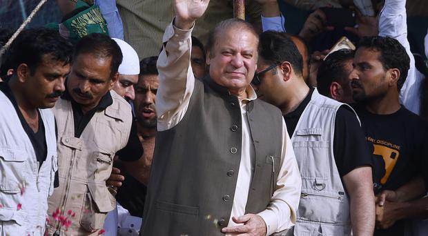 Deposed Pakistani PM Nawaz Sharif waves to supporters as he arrives to address a rally