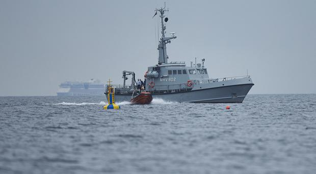 Danish maritime authorities work on a salvage operation south of the island of Amager, close to Copenhagen (AP)