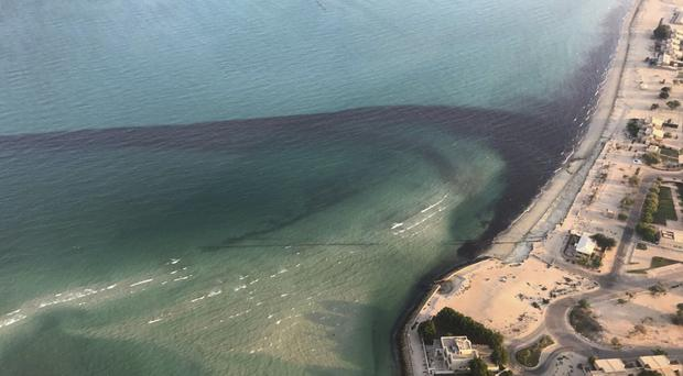 An oil spill near Kuwait's southern Ras al-Zour in Persian Gulf waters (Kuwait Environment Public Authority/AP)