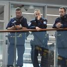 Armed police on guard at Helsinki airport after an stabbing incident in Turku, Finland. (Lehtikuva via AP)