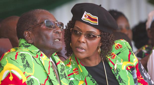 Zimbabwean president Robert Mugabe, left, and his wife Grace (AP/Tsvangirayi Mukwazhi)