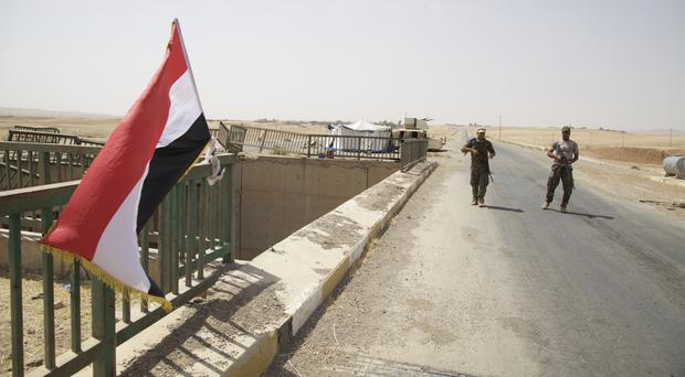 Iraqi soldiers guarding a bridge on the road to Tel Afar, as the operation to retake the town from Islamic State began (AP Photo/Balint Szlanko)