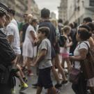 A policewoman stands guard on Las Ramblas promenade in Barcelona, Spain (AP Photo/Santi Palacios)