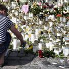 A memorial for the victims of Friday's stabbings in Turku (Lehtikuva/AP)