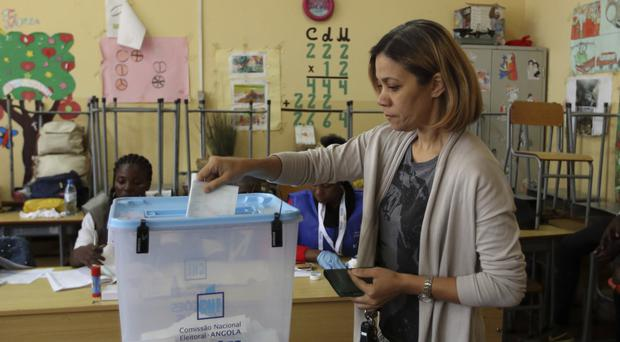 A woman casts her vote in elections in Luanda, Angola (AP)
